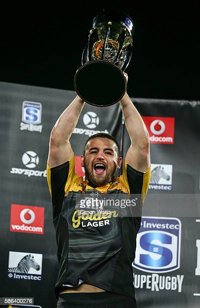 Danes Coles of the Hurricanes hoists the Super Rugby Trophy after the Hurricanes won the 2016 Super Rugby Final match between the Hurricanes and the...