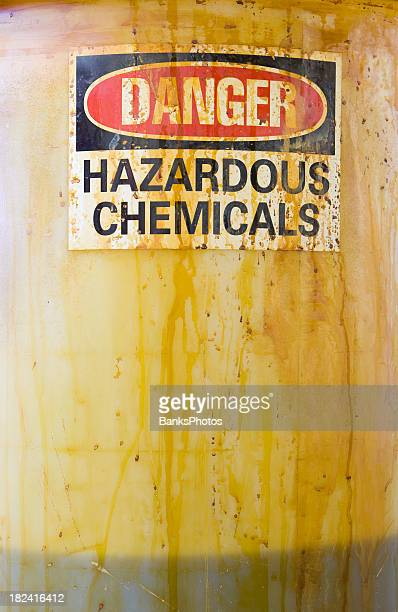 Danger Hazardous Chemicals Sign on a Translucent Barrel with Liquid
