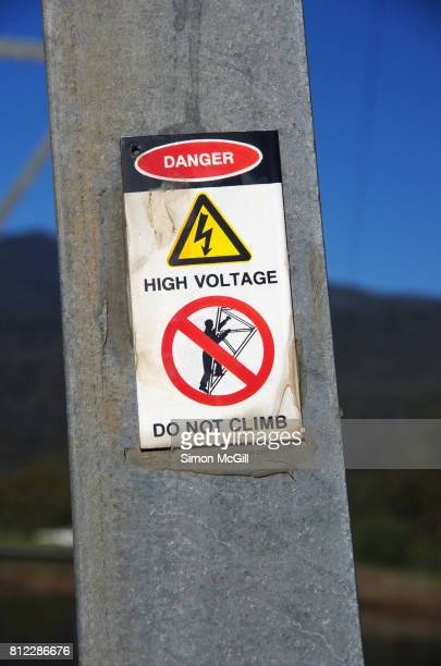 Danger, high voltage, do not climb warning sign on an electricity pylon in Mount Beauty, Victoria, Australia