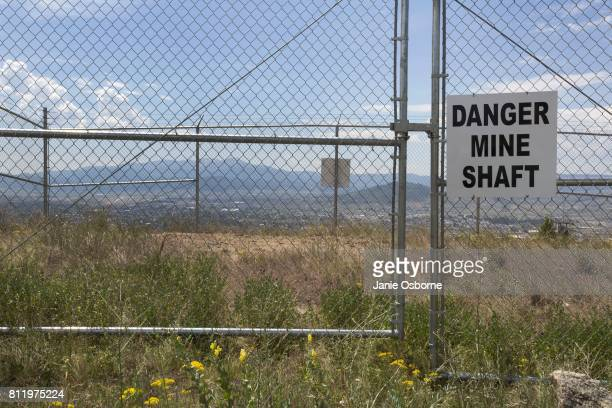 A 'Danger Mine Shaft' sign is located near the Berkeley Pit on July 6 2017 in Butte Montana Formerly an open pit copper mine today the Berkeley Pit...