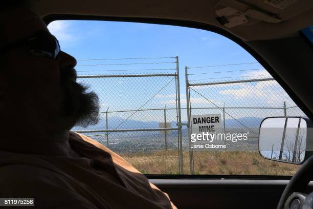 A 'Danger Mine Shaft' sign is viewed through the car window as Thomas Malloy Reclamation Inspector for the ButteSilver Bow County Planning...