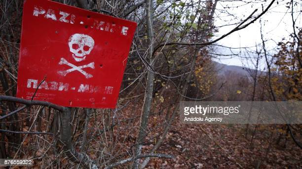A 'danger of death' sign is seen at a minefield in a woodland in Sarajevo Bosnia and Herzegovina on November 20 2017 22 years after the signing of...