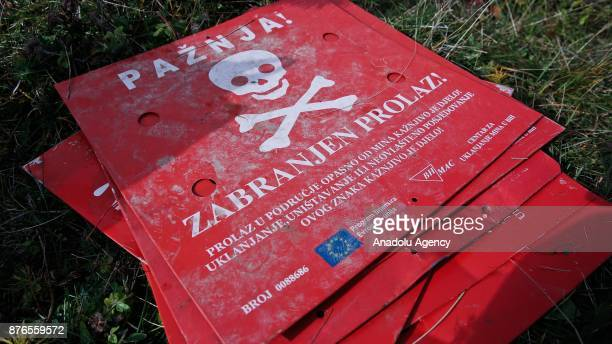 'Danger of death' signs are seen at a minefield in a woodland in Sarajevo Bosnia and Herzegovina on November 20 2017 22 years after the signing of...