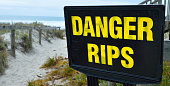 Danger rips of strong currents sign posted on the beach. copy space concept conceptual.