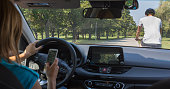 Woman driving and texting on cell phone and not paying attention to the road. Hit a man on a bicycle. Dangerous situation.