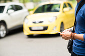 Man text messaging while crossing the road