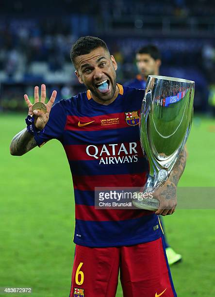 Dani Aleves of Barcelona celebrates with the UEFA Super Cup after the UEFA Super Cup between Barcelona and Sevilla FC at Dinamo Arena on August 11...