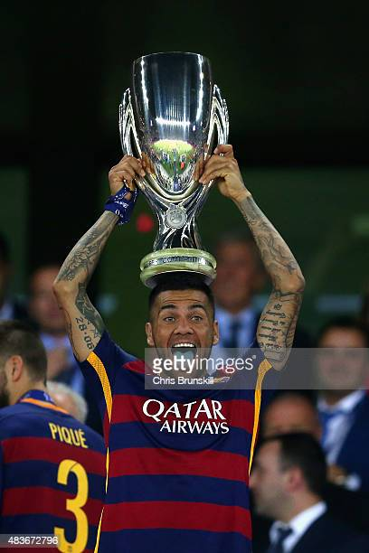 Dani Aleves of Barcelona lifts the UEFA Cup trophy as Barcelona celebrate victoy during the UEFA Super Cup between Barcelona and Sevilla FC at Dinamo...