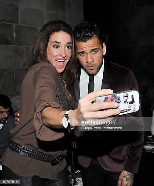Dani Alves and Elsa Anka attend the front row of TCN show during the Barcelona 080 Fashion Week Autumn/Winter 2016/2017 at Casa Llotja de Mar on...