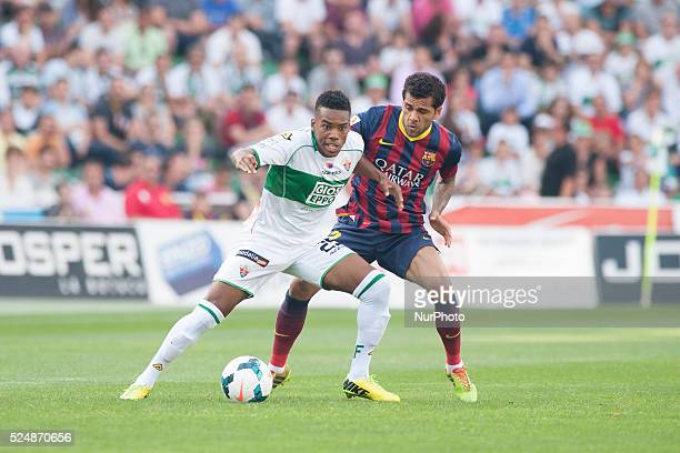 Dani Alves and Garry Mendes in the match between Elche and FC Barcelona for Week 37 of the spanish Liga BBVA played at the Martinez Valero Stadium...