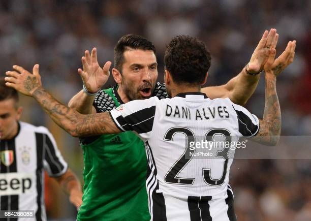 Dani Alves celebrates with Gianluigi Buffon after scoring goal 10 during the Tim Cup football match FC Juventus vs SS Lazio at the Olympic Stadium in...