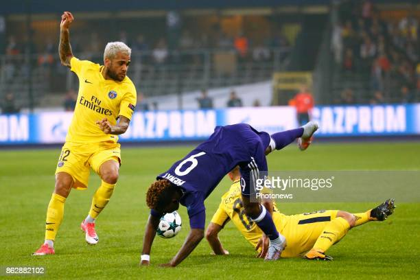 Dani Alves defender of PSG and Henry Onyekuru forward of RSC Anderlecht and Marco Verratti midfielder of PSG during the Champions League Group B...