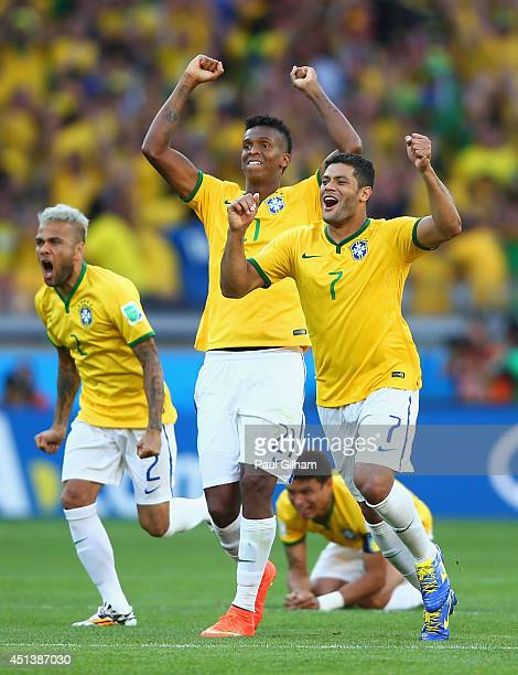 Dani Alves Jo and Hulk of Brazil react after defeating Chile in a penalty shootout during the 2014 FIFA World Cup Brazil round of 16 match between...