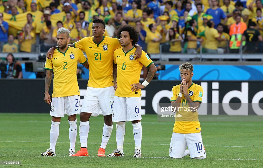 Dani Alves, Jo, Marcelo and Neymar of Brazil look on during the penalty shootout of the 2014 FIFA World Cup Brazil round of 16 match between Brazil and Chile at Estadio Mineirao on June 28, 2014 in Belo Horizonte, Brazil.