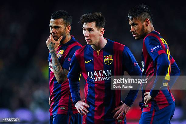 Dani Alves Lionel Messi and Neymar of FC Barcelona look on during the UEFA Champions League round of 16 second leg match between FC Barcelona and...