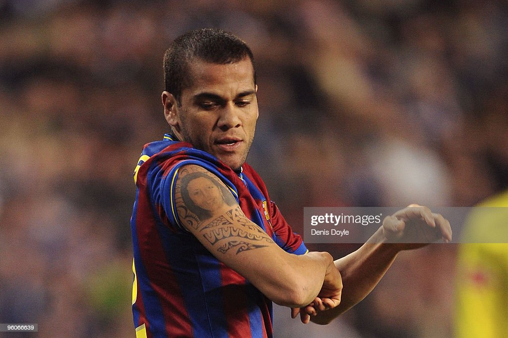 <a gi-track='captionPersonalityLinkClicked' href=/galleries/search?phrase=Dani+Alves&family=editorial&specificpeople=2191863 ng-click='$event.stopPropagation()'>Dani Alves</a> of Barcelona celebrates after scoring Barcelona's second goal in the La Liga match between Valladolid and Barcelona at the Jose Zorilla stadium on January 23, 2010 in Valladolid, Spain.