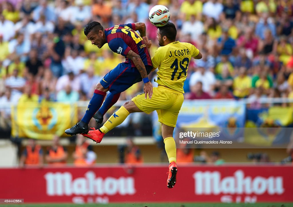 <a gi-track='captionPersonalityLinkClicked' href=/galleries/search?phrase=Dani+Alves&family=editorial&specificpeople=2191863 ng-click='$event.stopPropagation()'>Dani Alves</a> (L) of Barcelona competes for a high ball with Jaume Costa of Villarreal during the La Liga match between Villarreal CF and FC Barcelona at El Madrigal stadium on August 31, 2014 in Villarreal, Spain.