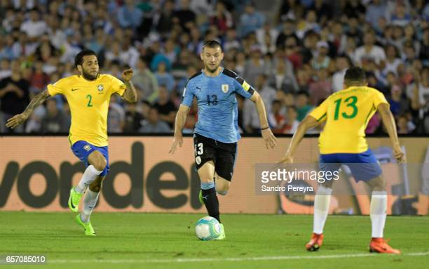 Dani Alves of Brasil and Gaston Silva of Uruguay fight for the ball during a match between Uruguay and Brazil as part of FIFA 2018 World Cup...