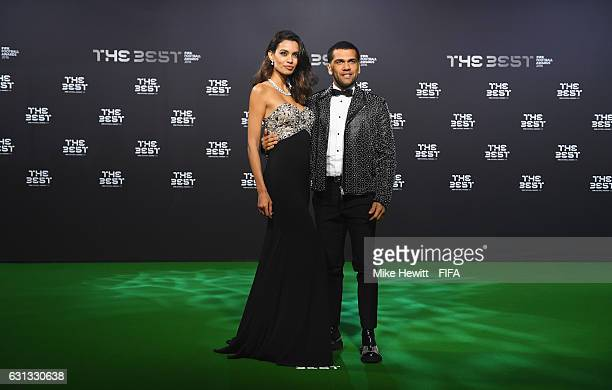 Dani Alves of Brazil and Juventus and girlfriend Joana Sanz pose as they arrive for The Best FIFA Football Awards at TPC Studio on January 9 2017 in...