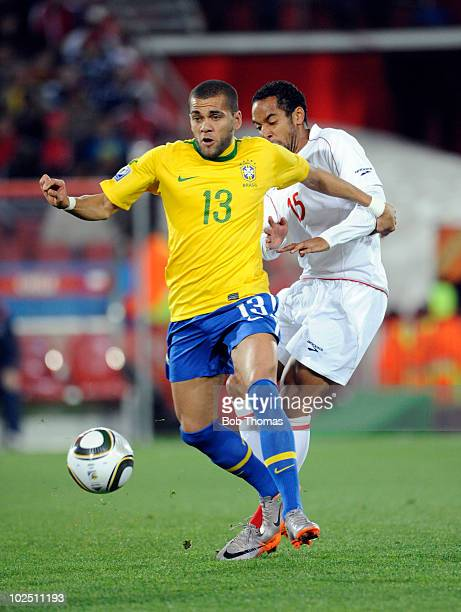 Dani Alves of Brazil challenged by Jean Beausejour of Chile during the 2010 FIFA World Cup South Africa Round of Sixteen match between Brazil and...