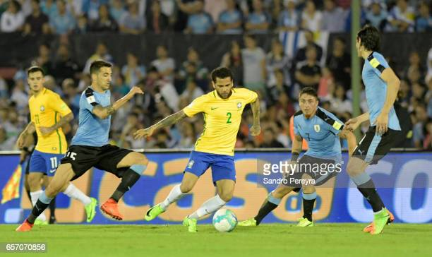 Dani Alves of Brazil fights for the ball with Matias Vecino Cristian Rodriguez and Edinson Cavani of Uruguay during a match between Uruguay and...