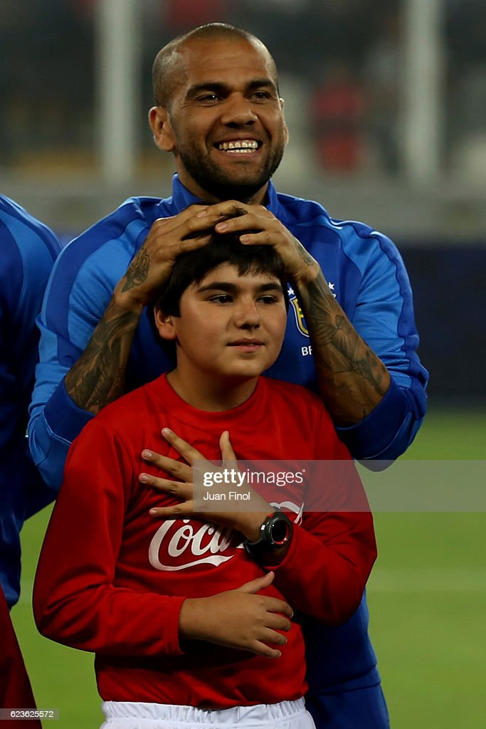 Dani Alves of Brazil smiles prior a match between Peru and Brazil as part of FIFA 2018 World Cup Qualifiers at Nacional Stadium on November 15, 2016 in Lima, Peru.