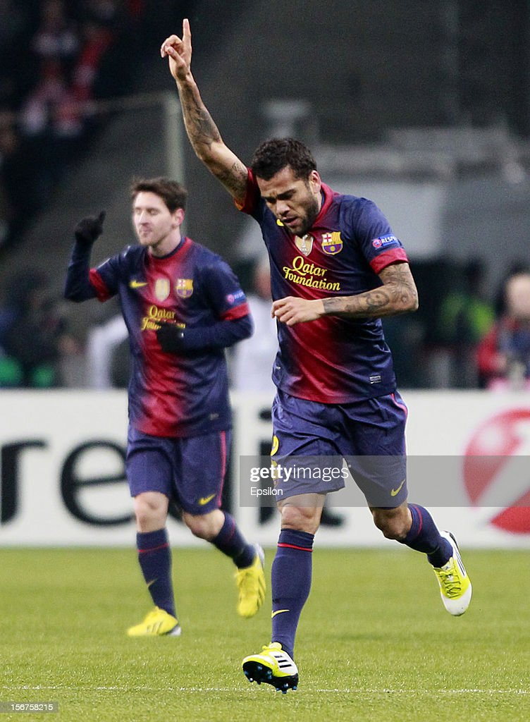 <a gi-track='captionPersonalityLinkClicked' href=/galleries/search?phrase=Dani+Alves&family=editorial&specificpeople=2191863 ng-click='$event.stopPropagation()'>Dani Alves</a> of FC Barcelona celebrates after scoring a goal during the UEFA Champions League group G match between FC Spartak Moscow and FC Barcelona at the Luzhniki Stadium on November 20, 2012 in Moscow, Russia.