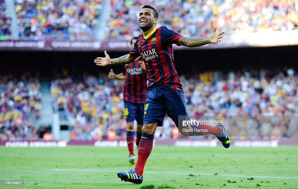 <a gi-track='captionPersonalityLinkClicked' href=/galleries/search?phrase=Dani+Alves&family=editorial&specificpeople=2191863 ng-click='$event.stopPropagation()'>Dani Alves</a> of FC Barcelona celebrates after scoring his team's third goal during the La Liga match between FC Barcelona and Levante UD at Camp Nou on August 18, 2013 in Barcelona, Spain.