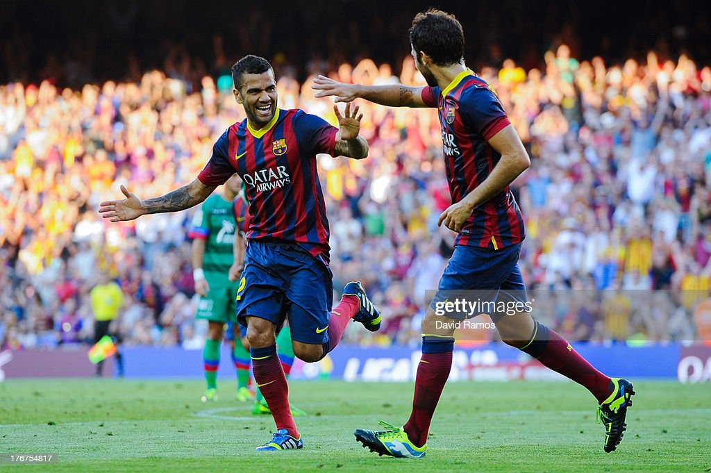 <a gi-track='captionPersonalityLinkClicked' href=/galleries/search?phrase=Dani+Alves&family=editorial&specificpeople=2191863 ng-click='$event.stopPropagation()'>Dani Alves</a> of FC Barcelona (L) celebrates with his team-mate Cesc Fabregas after scoring his team's third goal during the La Liga match between FC Barcelona and Levante UD at Camp Nou on August 18, 2013 in Barcelona, Spain.