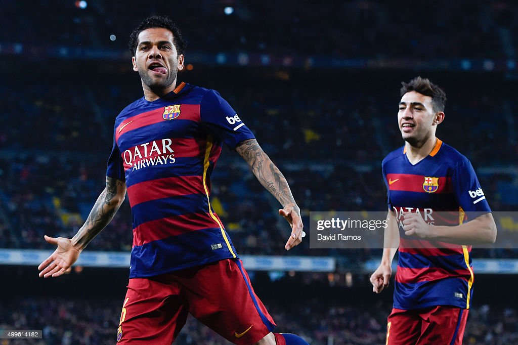 Dani Alves (L) of FC Barcelona celebrates with his teammate Munir el Haddadhi of FC Barcelona after scoring the opening goal during the Copa del Rey Round of 32 second leg match betwen FC Barcelona and Villanovense on December 2, 2015 in Barcelona, Spain.