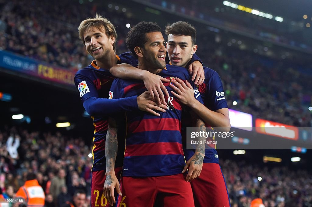 Dani Alves (C) of FC Barcelona celebrates with his teammates Sergi Samper (L) of FC Barcelona and Munir el Haddadhi of FC Barcelona after scoring the opening goal during the Copa del Rey Round of 32 second leg match betwen FC Barcelona and Villanovense on December 2, 2015 in Barcelona, Spain.