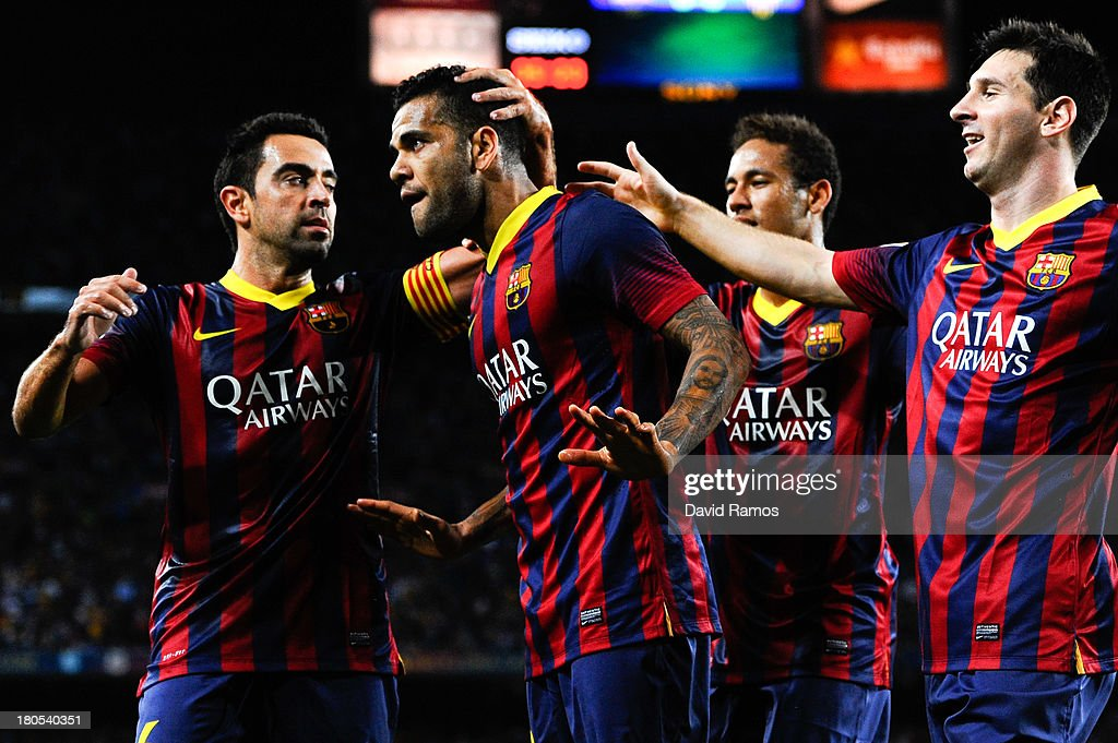 <a gi-track='captionPersonalityLinkClicked' href=/galleries/search?phrase=Dani+Alves&family=editorial&specificpeople=2191863 ng-click='$event.stopPropagation()'>Dani Alves</a> of FC Barcelona (2ndL) celebrates with his team-mates <a gi-track='captionPersonalityLinkClicked' href=/galleries/search?phrase=Xavi+Hernandez+-+Soccer+Player&family=editorial&specificpeople=2834438 ng-click='$event.stopPropagation()'>Xavi Hernandez</a> (L), Neymar (2ndR) and <a gi-track='captionPersonalityLinkClicked' href=/galleries/search?phrase=Lionel+Messi&family=editorial&specificpeople=453305 ng-click='$event.stopPropagation()'>Lionel Messi</a> of FC Barcelona after scoring the opening goal the La Liga match between FC Barcelona and Sevilla FC at Camp Nou on September 14, 2013 in Barcelona, Spain.