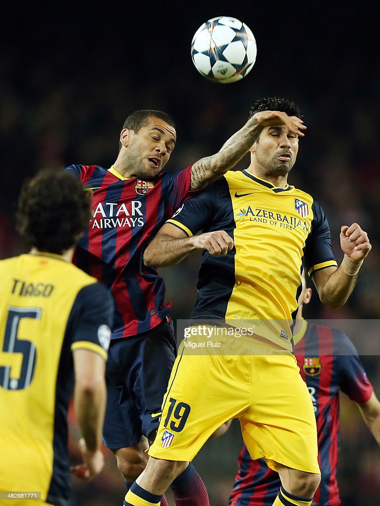 Dani Alves (L) of FC Barcelona competes for the ball with Diego Costa of Club Atletico de Madrid during the Champions League quarter finals first leg between FC Barcelona and Club Atletico de Madrid at Nou Camp on April 1, 2014 in Barcelona, Spain.