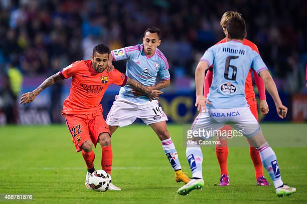 Dani Alves of FC Barcelona competes for the ball with Fabian Orellana of Celta Vigo during the La Liga match between Celta Vigo and FC Barcelona at...