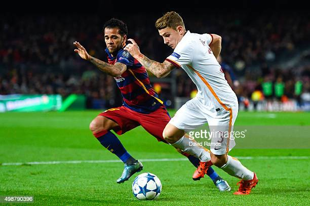 Dani Alves of FC Barcelona competes for the ball with Lucas Digne of AS Roma during the UEFA Champions League Group E match between FC Barcelona and...