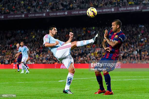 Dani Alves of FC Barcelona competes for the ball with Nolito of Celta de Vigo the La Liga match between FC Barcelona and Celta de Vigo at Camp Nou on...