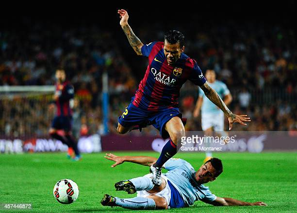 Dani Alves of FC Barcelona duels for the ball with Dani Garcia of SD Eibar during the La Liga match between FC Barcelona and SD Eibar at Camp Nou on...