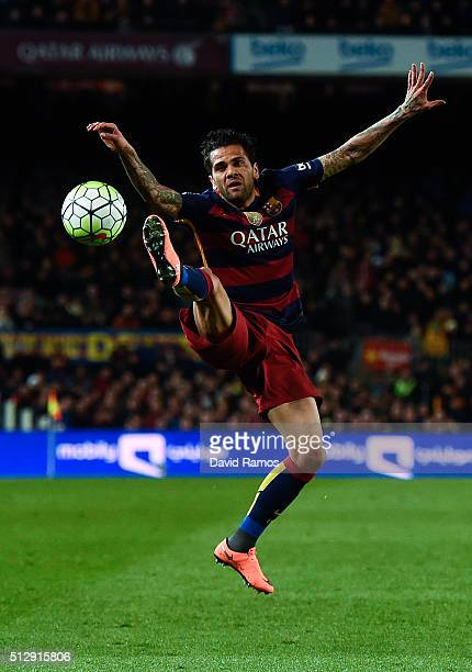 Dani Alves of FC Barcelona jumps to control the ball during the La Liga match between FC Barcelona and Sevilla FC at Camp Nou on February 28 2016 in...
