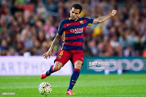 Dani Alves of FC Barcelona kicks the ball during the La Liga match between FC Barcelona and Levante UD at Camp Nou on September 20 2015 in Barcelona...