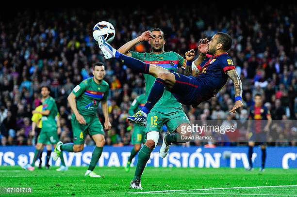 Dani Alves of FC Barcelona performs and overhead kick under a pressure from Juanfran Garcia of Levante UD during the La Liga match between FC...