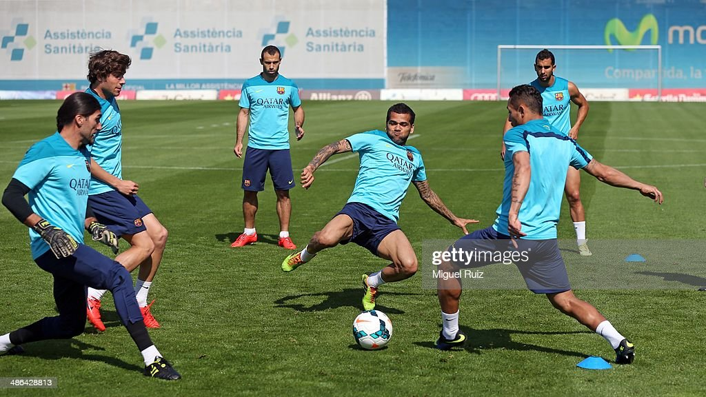 <a gi-track='captionPersonalityLinkClicked' href=/galleries/search?phrase=Dani+Alves&family=editorial&specificpeople=2191863 ng-click='$event.stopPropagation()'>Dani Alves</a> (C) of FC Barcelona plays in action with his team-mates Adriano, <a gi-track='captionPersonalityLinkClicked' href=/galleries/search?phrase=Jose+Manuel+Pinto&family=editorial&specificpeople=708358 ng-click='$event.stopPropagation()'>Jose Manuel Pinto</a>, <a gi-track='captionPersonalityLinkClicked' href=/galleries/search?phrase=Martin+Montoya&family=editorial&specificpeople=5553159 ng-click='$event.stopPropagation()'>Martin Montoya</a>, <a gi-track='captionPersonalityLinkClicked' href=/galleries/search?phrase=Javier+Mascherano&family=editorial&specificpeople=490876 ng-click='$event.stopPropagation()'>Javier Mascherano</a> and <a gi-track='captionPersonalityLinkClicked' href=/galleries/search?phrase=Sergi+Roberto&family=editorial&specificpeople=6518611 ng-click='$event.stopPropagation()'>Sergi Roberto</a> during the training session at Ciutat Esportiva on April 24, 2014 in Barcelona, Spain.