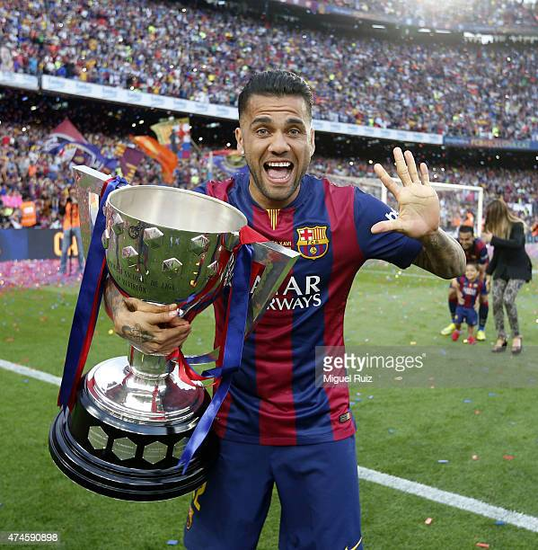 Dani Alves of FC Barcelona poses with La Liga trophy during the La Liga match between FC Barcelona and RC Deportivo La Coruña at Camp Nou on May 23...