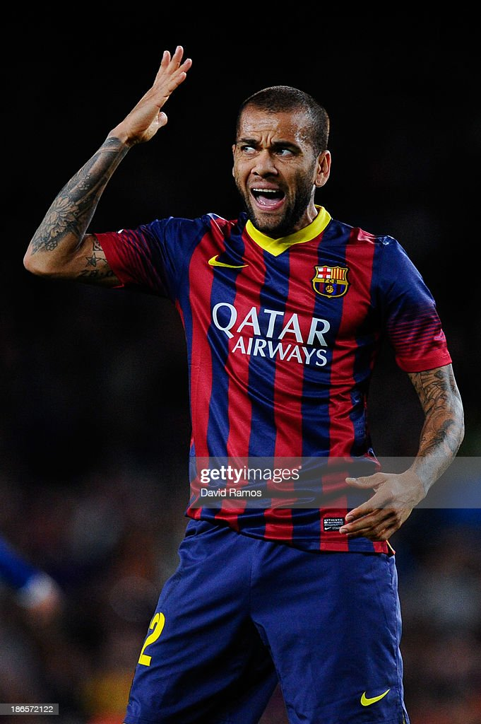 Dani Alves of FC Barcelona reacts after missing a chance to score during the La Liga match between FC Barcelona and RCD Espanyol at Camp Nou on November 1, 2013 in Barcelona, Spain.