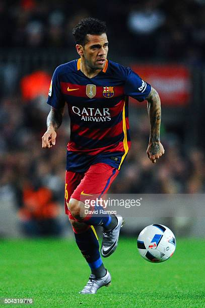 Dani Alves of FC Barcelona runs with the ball during the Copa del Rey Round of 16 first leg match between FC Barcelona and RCD Espanyol at Camp Nou...
