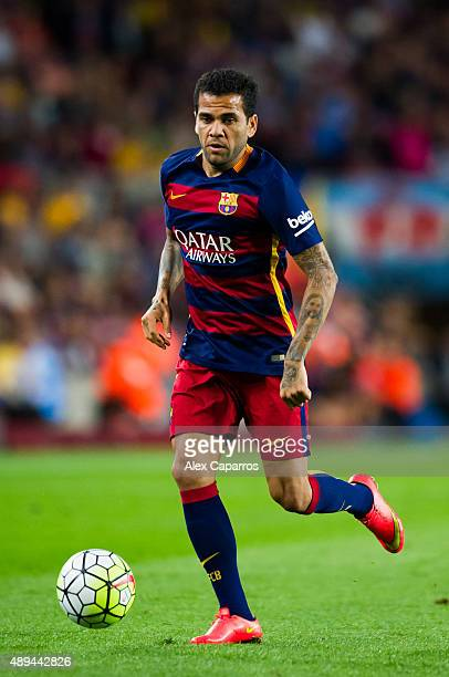 Dani Alves of FC Barcelona runs with the ball during the La Liga match between FC Barcelona and Levante UD at Camp Nou on September 20 2015 in...