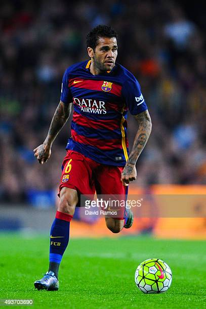 Dani Alves of FC Barcelona runs with the ball during the La Liga match between FC Barcelona and Rayo Vallecano at the Camp Nou stadium on October 17...
