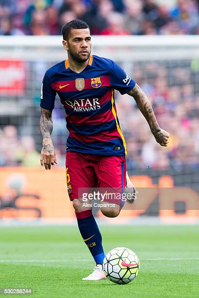 Dani Alves of FC Barcelona runs with the ball during the La Liga match between FC Barcelona and RCD Espanyol at Camp Nou on May 8 2016 in Barcelona...