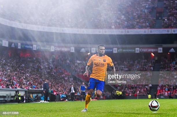 Dani Alves of FC Barcelona runs with the ball during the Spanish Super Cup first leg match between FC Barcelona and Athletic Club at San Mames...