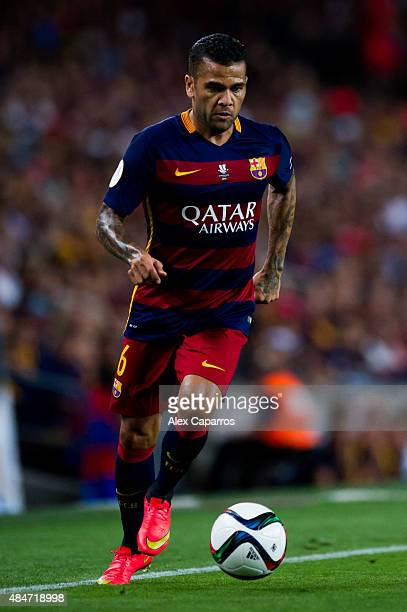 Dani Alves of FC Barcelona runs with the ball during the Spanish Super Cup second leg match between FC Barcelona and Athletic Club at Camp Nou on...