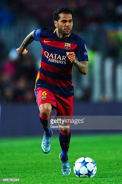 Dani Alves of FC Barcelona runs with the ball during the UEFA Champions League Group E match between FC Barcelona and AS Roma at Camp Nou stadium on...